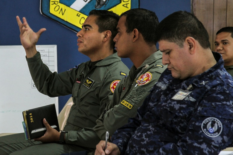 Members of the El Salvadorian Air Force ask questions and take notes during a subject matter expert exchange at Ilopango AB, El Salvador, April 2, 2014.  The subject matter expert exchange occurred from April 1-4 and included topics on imagery collection and processing. (U.S. Air Force photo by Staff Sgt. Heather Redman/Released)