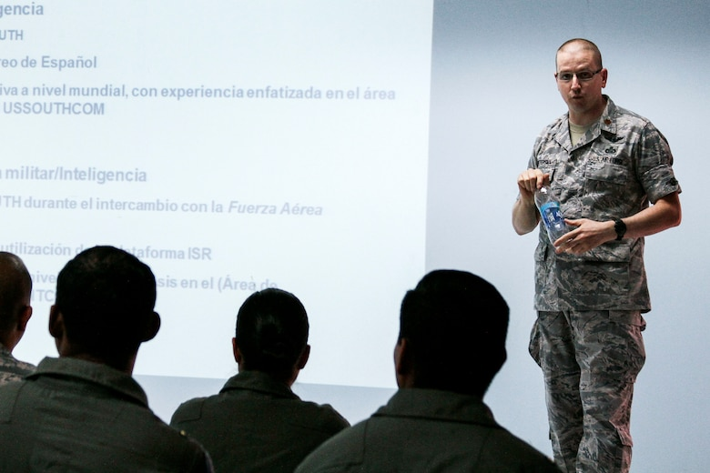 Maj. Douglas Pietersma, from the 12th Air Force (Air Forces Southern) intelligence directorate, briefs members of the El Salvadorian Air Force during a subject matter expert exchange at Ilopango AB, El Salvador, April 2, 2014.  The subject matter expert exchange occurred from April 1-4 and included topics on imagery collection and processing. (U.S. Air Force photo by Staff Sgt. Heather Redman/Released)