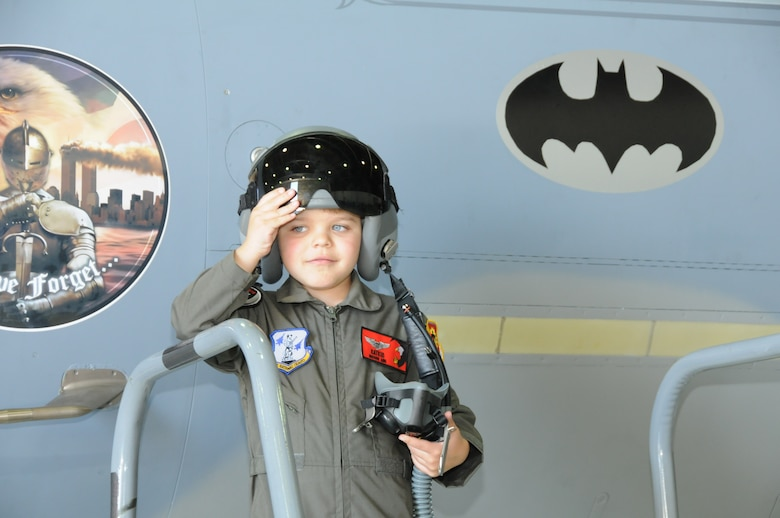 """Miles Scott, call sign,""""Batkid"""", reported for duty at the 173rd Fighter Wing in Klamath Falls, Ore., April 10, 2014. Scott is in remission from leukemia and had the opportunity to be a part of the Fighter Pilot for a Day program hosted by the 114th Fighter Squadron. The jet bears a batman symbol which crew chief Tech. Sgt. Cliff Rutledge had affixed to the jet in honor of Scott's visit. Scott has battled leukemia and his doctors have recently said he is in remission. (U.S. Air Force photo by Tech. Sgt. Jefferson Thompson/released)"""