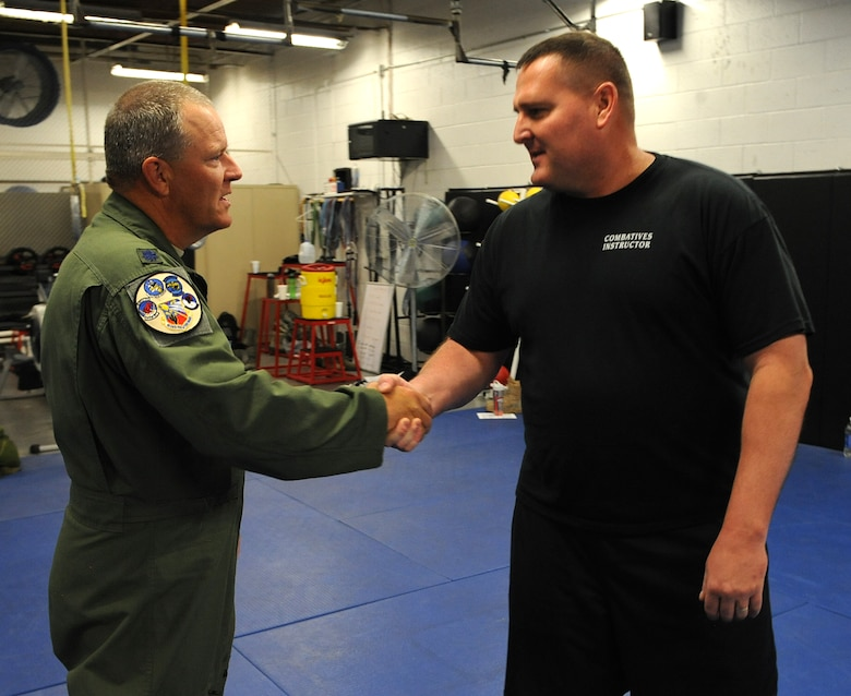 "Offering thanks for his tutelage, 162nd Wing Vice Commander Lt. Col. Kenneth Rosson shakes the hand of Army National Guard instructor Sgt. Major Mark Ruffe at the Western Army National Guard Aviation Training Site gym in Marana, Ariz., March  21. ""We want the Security Forces to continue the training opportunities like this with the Army,"" said Rosson. ""I think they might have even had a bit of fun, but this fantastic training with the Army amplified the fighting Airman spirit needed for operations down-range and here in the homeland."""