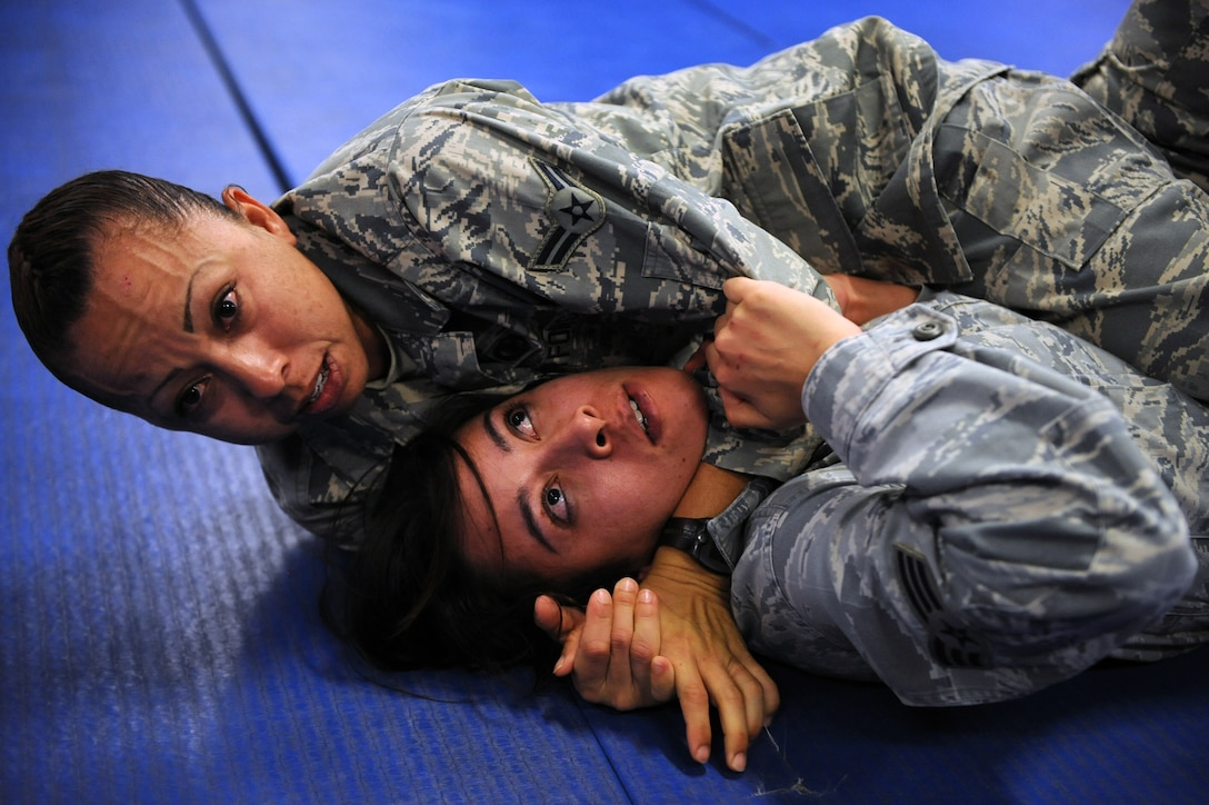It's just business….nothing personal. Airman 1st Class Anna Solis applies a free-style stranglehold on Senior Airman Jessica Switzer on March 21 at the Western Army National Guard Aviation Training Site gym in Marana, Ariz. The two security forces specialists were part of an intense 5-day, Army National Guard-instructed training event titled Basic Combative Course. (U.S. Air Force Photo by Airman 1st Class Chris Drzazgowski/Released)