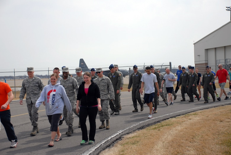 "Members of the 107th Airlift Wing participate in the ""Walk A Mile"" Sexual Assault Awareness Walk held here April 13, 2014. (U.S. Air National Guard photo/Senior Airman Daniel Fravel)"