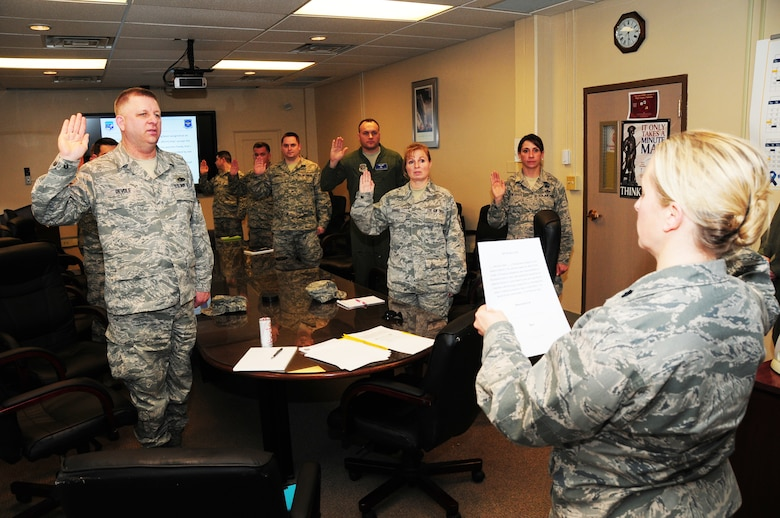Lt. Col. Jennifer Post, 107th Inspector General, swears in members of the 107th Airlift Wing as the new Wing Inspection Team at the Niagara Falls Reserve Station on April 13, 2014. (U.S. Air National Guard Photo/Senior Master Sgt. Ray Lloyd)