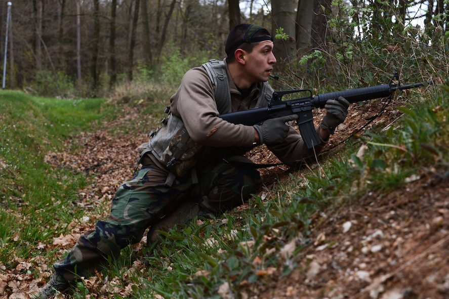 U.S. Air Force Senior Airman Isaac Martinez-Trevino, 606th Air Control Squadron command and control battle field management from Santa Maria, Calif., scouts out targets during a combat readiness training course at Spangdahlem Air Base, Germany, April 15, 2014. The 606th ACS has 21 different career fields that provide support for a self-contained unit. (U.S. Air Force photo by Airman 1st Class Kyle Gese/Released)