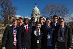 Air Force Maj. Jason Park, chief of safety with the Wisconsin Air National Guard's 128th Air Refueling Wing, stands outside the U.S. Capitol building with the group of students he escorted throughout Washington, D.C., during their weeklong visit as part of the U.S. Senate Youth Program.