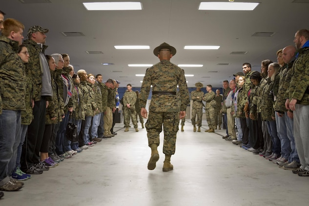 U.S. Marine Corps Sgt. Jessie Ontiveros, a drill instructor at Marine Corps Recruit Depot Parris Island, S.C., simulates morning reveille inside of a squad bay for teachers from the greater Maryland area during the first day of Recruiting Station Baltimore's Educators Workshop at MCRD Parris Island, S.C. The Educators Workshop is a four-day event that is intended to offer educators a practical knowledge of the Marine Corps and impress upon them the continual need to recruit highly qualified men and women. (U.S. Marine Corps photo by Sgt. Bryan Nygaard/Released)
