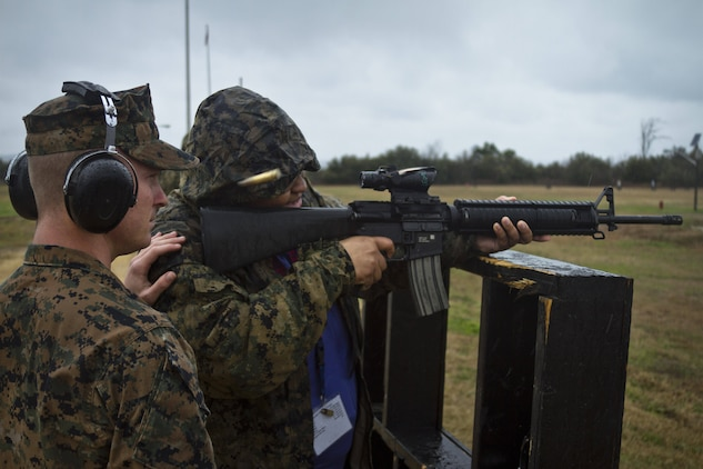 April Powell, right, a guidance counselor at Snow Hill High School in Snow Hill, MD, fires a M16A4 service rifle during the first day of Recruiting Station Baltimore's Educators Workshop at Marine Corps Recruit Depot Parris Island, S.C. The Educators Workshop is a four-day event that is intended to offer educators a practical knowledge of the Marine Corps and impress upon them the continual need to recruit highly qualified men and women. (U.S.