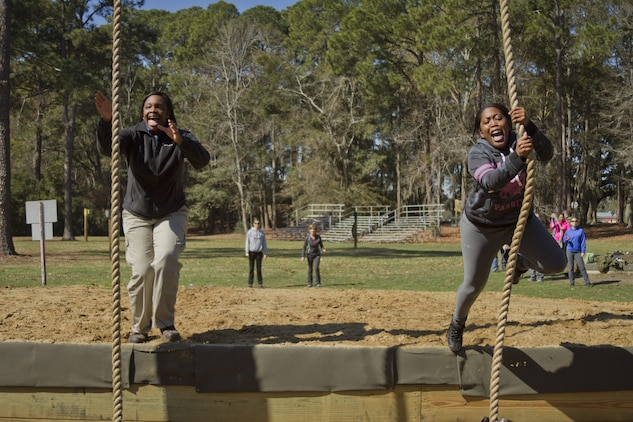 Michelle James, left, a guidance counselor at Maurice J. McDonough High School in Pomfret, Md., and Kari Mason, a guidance counselor at Charles H. Flowers High School in Springdale, Md., negotiate an obstacle on the confidence course during the second day of Recruiting Station Baltimore's Educators Workshop at Marine Corps Recruit Depot Parris Island, S.C. The Educators Workshop is a four-day event that is intended to offer educators a practical knowledge of the Marine Corps and impress upon them the continual need to recruit highly qualified men and women. (U.S. Marine Corps photo by Sgt. Bryan Nygaard/Released)
