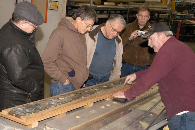 DAYTON, Ohio - Museum volunteer Tim Ward shows visitors restoration techniques during the Behind the Scenes Tour of the restoration area. (U.S. Air Force photo by Ken LaRock)