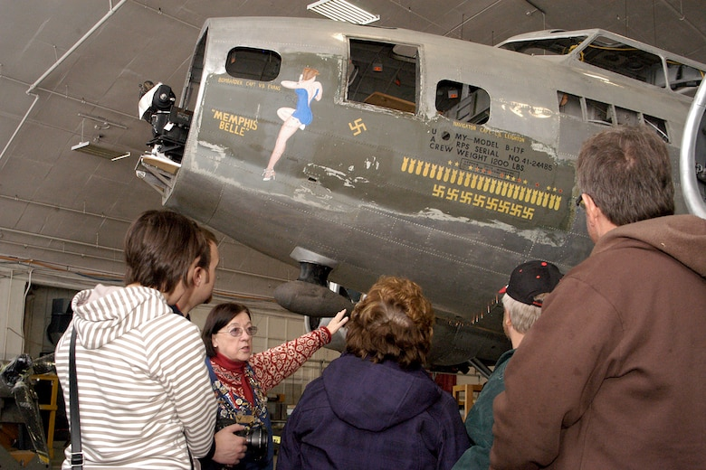 DAYTON, Ohio - Museum volunteer Beverly Smith walks visitors through the Behind the Scenes Tour of the restoration area. The Memphis Belle is one of the restoration projects that visitors can view. (U.S. Air Force photo by Ken LaRock)