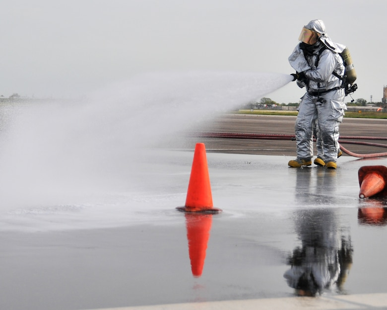 Members from the 147th Reconnaissance Wing Fire Department respond to a simulated aircraft fire while participating in an Operational Readiness Exercise at Ellington Field JRB, Houston, April 5, 2014. The firefighters were evaluated on their speed and accuracy of response during mock war-time activities.