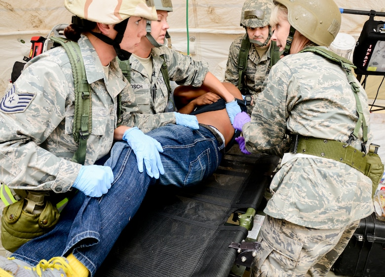 Members of the 147th Reconnaissance Wing Medical Group treat a simulated victim of a mass casualty event during an Operational Readiness Exercise April 4, 2014 at Ellington Field Joint Reserve Base, Houston, TX. The scenario tested the Medical Group's readiness and efficiency to respond to a real world event.