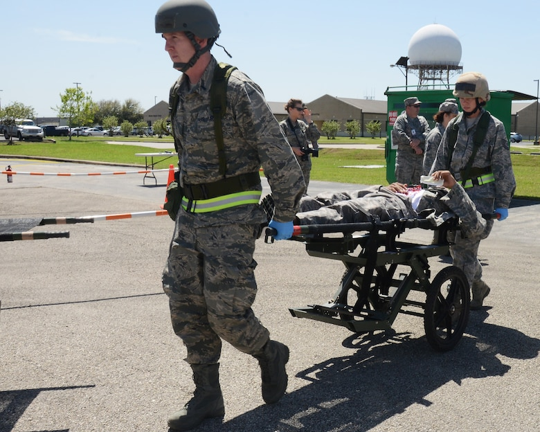 Members of the 147th Reconnaissance Wing Medical Group evacuate a simulated victim of a mass casualty event during an Operational Readiness Exercise April 4, 2014 at Ellington Field Joint Reserve Base, Houston, TX. The scenario tested the Medical Group's ability to respond to a real world emergency.