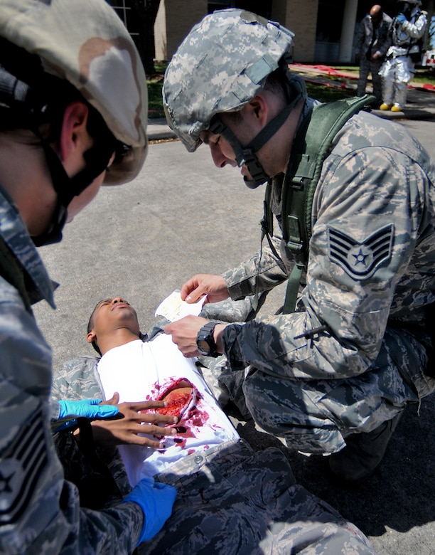 Members of the 147th Medical Group treat a simulated victim during a mass casualty scenario as part an Operational Readiness Exercise at Ellington Field Joint Reserve Base, Houston, April 4, 2014. The mass casualty scenario tested the capabilities of both the fire department and the medical groups ability to respond to a real world emergency.