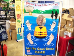 David Cable, recipient of a National Water Safety Congress letter of commendation, spreads the water safety message at the USACE Water Safety Booth at the 2014 Indianapolis Boat & Travel Show.