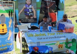 Buckhorn Lake Park Ranger Billy Griffin and Maintenance Mechanic Nate Hoskins staff a Corps water safety booth.