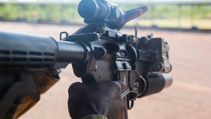 A Soldier with the Australian Army prepares to fire a M4 Carbine, aboard Robertson Barracks, April 15, 2014. The Australians fired the M4 carbine, the M16A4 Service Rifle and the M27 infantry automatic rifle. The Marines also instructed them on the proper use and care of the weapon systems.