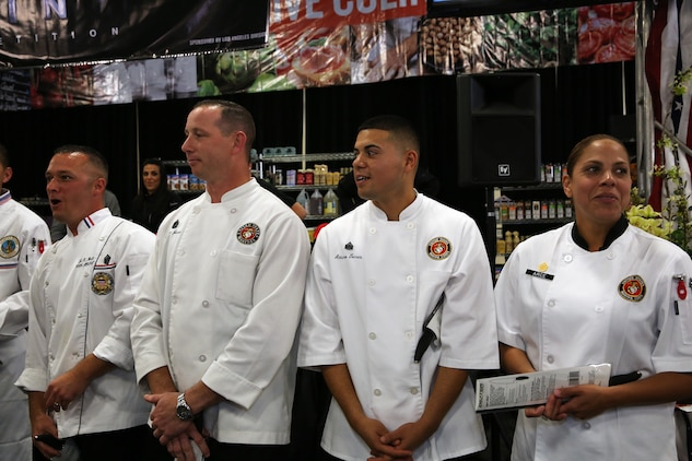 Chefs from the Marine Corps Installations West region wait for the winners to be announced at the Boiling Points competition held at the Del Mar Fairgrounds April 16. Boiling Points is a competition hosted by Aaron Williams, the corporate division chef for Food Fanatics, Los Angeles. The competition challenged the Marine Corps, Army, Navy and Coast Guard to go head-to-head in a 45-minute cooking competition. The Marine team took 1st place with their dish of an appetizer of fried eggplant and seared scallop caprese, and an entrée of seared duck, sweet potatoes and a fruit medley with a star fruit and horn melon sauce.