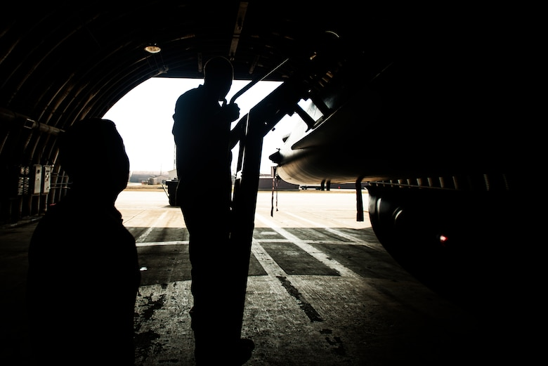 Marine Corps Cpl. Jake Balcom is shown an F-16 by Capt. Jay Doerfler, 421st Fighter Squadron chief of training, while touring the 421st FS March 26, 2014, at Osan Air Base, Republic of Korea. Balcom is the grandson of Col. Ralph Balcom, a Vietnam-war POW/MIA, who served with the 421st FS. (U.S. Air Force photo by Staff Sgt. Jake Barreiro)