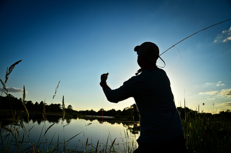 James Custer, a Project Healing Waters Fly Fishing participant, practices newly learned casting techniques at MacDill Air Force Base, Fla., April 17, 2014.  The group's most recent outing took place at MacDill Air Force Base's Lewis Lake, where volunteers aided participants as they honed their new-found casting skills and dipped their freshly tied flies. (U.S. Air Force photo by Staff Sgt. Brandon Shapiro/Released)