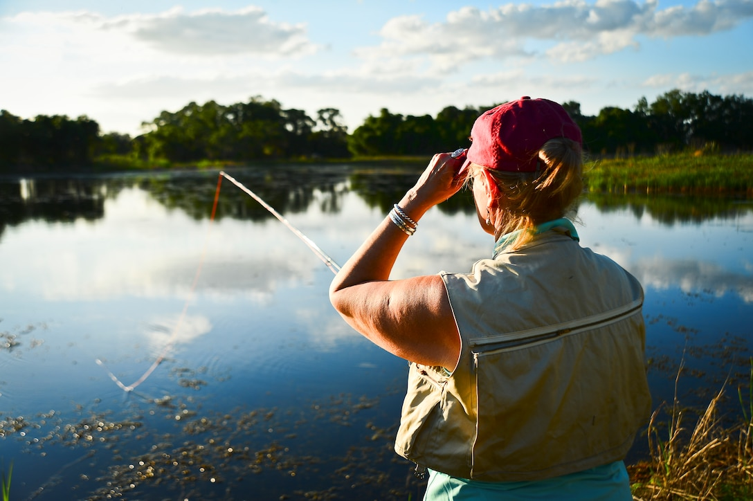 Deborah Brooks, Project Healing Waters Fly Fishing Tampa lead, demonstrates proper casting techniques during a class held at MacDill Air Force Base, April 17, 2014. Events like these are the backbone of the program; they give individuals the confidence to get out of their comfort zones and meet new people. With this, they are able to condition their mental and physical ailments in an environment that is relaxing and easy to enjoy from nearly anywhere. (U.S. Air Force photo by Staff Sgt. Brandon Shapiro/Released)