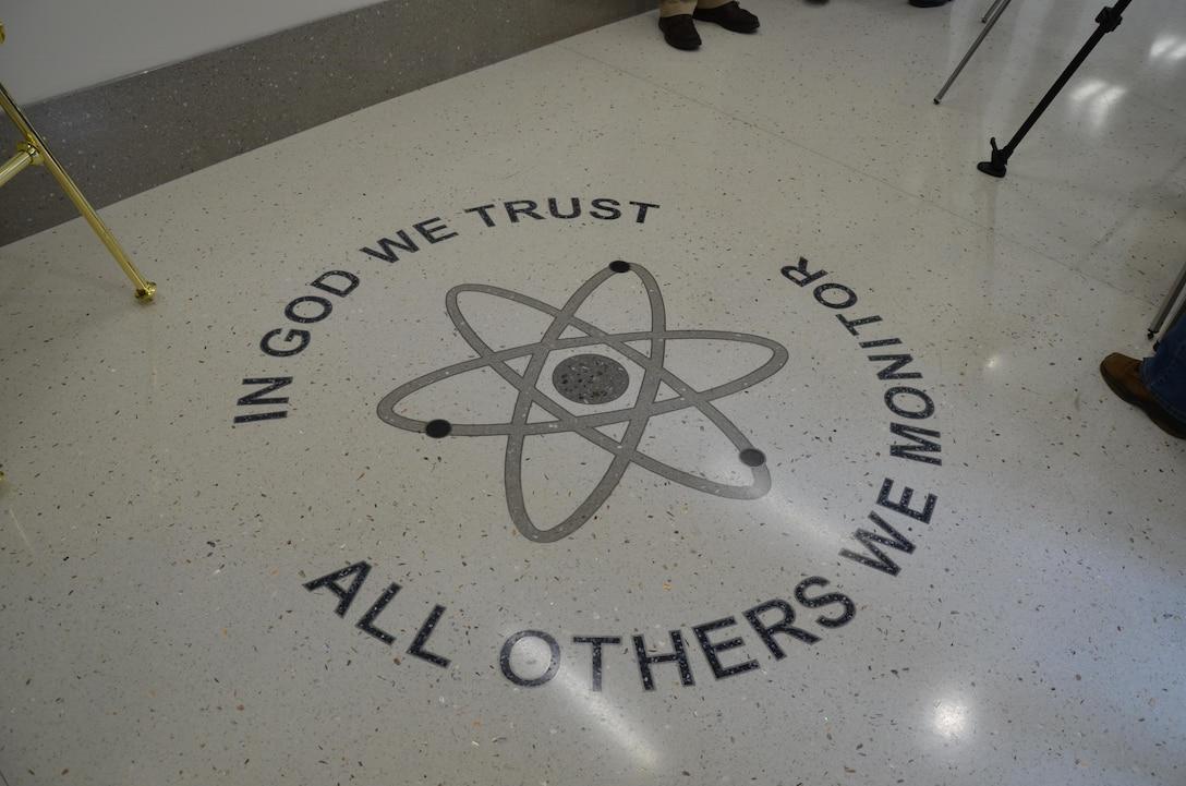 "The motto ""In God We Trust; All Others We Monitor"" is displayed in the foyer of the Air Force Technical Applications Center's new radiochemistry laboratory at Patrick AFB, Fla. The laboratory is a key component of the new four-structure campus, and will provide enhanced capabilities for AFTAC, the only Department of Defense organization tasked with monitoring nuclear treaty compliance. (U.S. Air Force photo/Susan Romano)"