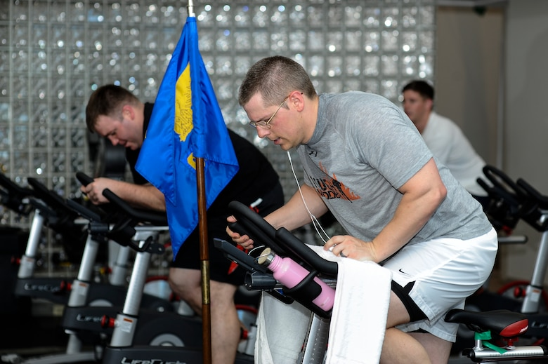 Team Buckley members work up a sweat during Buckley's annual Spin-A-Thon, April 11, 2014, at the fitness center on Buckley Air Force Base, Colo. Every hour, one person from each 460th Space Wing unit participated in a 45-minute spin class, competing for Commander's Cup points. (U.S. Air Force photo by Airman 1st Class Samantha Saulsbury/Released)