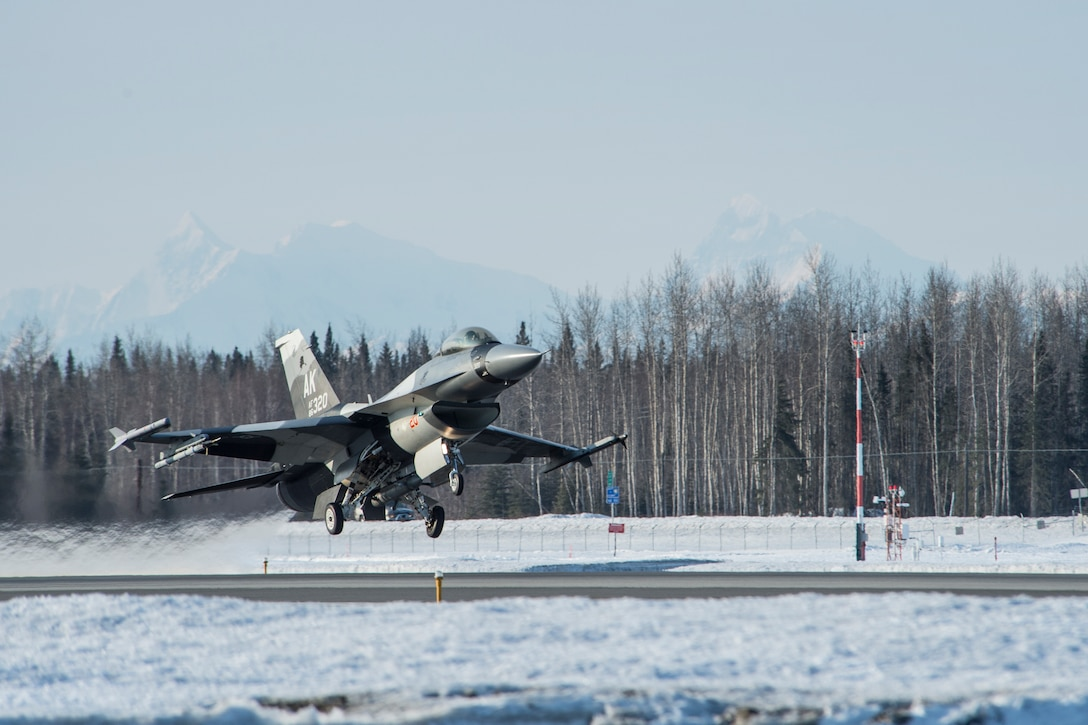An F-16 Fighting Falcon takes off during a training sortie April 3, 2014 at Eielson Air Force Base, Alaska. Regular flying hours ensure pilots stay sharp and mission ready. The F-16 is assigned to the 18th Aggressor Squadron. (U.S. Air Force photo/Senior Airman Peter Reft)