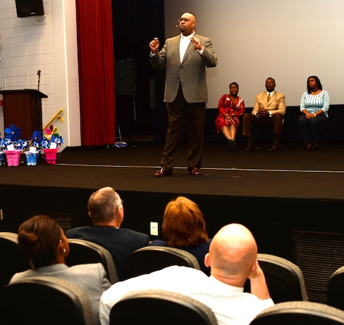 Dr. Ken Miller, senior pastor, Administering Grace Church and Spiritual Life Center, Albany, Ga., spoke at the Base Theater Tuesday during the Child Abuse Awareness Proclamation Ceremony.
