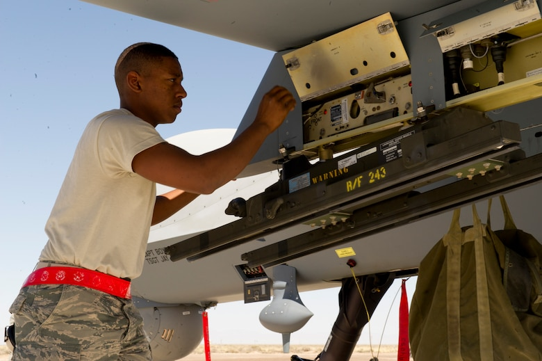 Airman 1st Class Ray Francis, a weapons load crew member  from the 849th Aircraft Maintenance Squadron, completes an aircraft preparation inspection on the MQ-9 Reaper to ensure the aircraft is ready for ammunition loading at Holloman Air Force Base, N.M., April 16. Francis was a part of a training exercise where the MQ-9 Reaper was loaded with live ammunitions in preparation for real world missions. (U.S. Air Force photo by Staff Sgt. E'Lysia Wray/Released)