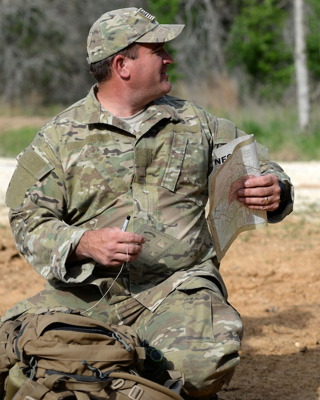 A tactical air control party members with the 147th Air Support Operations Squadron, 147th Reconnaissance Wing, based at Ellington Field Joint Reserve Base in Houston, Texas, prepares to navigate to his first point during a land navigation exercise at Camp Swift in Bastrop, Texas. The squadron travelled to the camp to perform a weeklong field training exercise that allowed the members to maintain their proficiency in their career field.