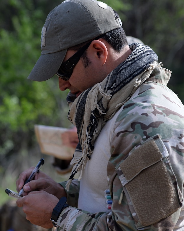 A tactical air control party member from the 147th Air Support Operations Squadron, 147th Reconnaissance Wing, based at Ellington Field Joint Reserve Base in Houston, Texas, prepare to navigate to their first point during a land navigation exercise at Camp Swift in Bastrop, Texas. The squadron travelled to the camp to perform a weeklong field training exercise that allowed the members to maintain their proficiency in their career field.
