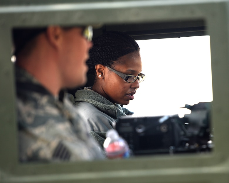 Staff Sgt. Ryan Hogue, the unit training manager with the 147th Air Support Operations Squadron, 147th Reconnaissance Wing, based at Ellington Field in Houston, Texas, trains Staff Sgt. Tyisha McNutt, a human resources assistant from the squadron, on driving a HUMVEE during a field training exercise April 4, 2014, at Camp Swift in Bastrop, Texas. The support personnel participated in the annual exercise to test the requirements necessitated by being members of an ASOS unit.