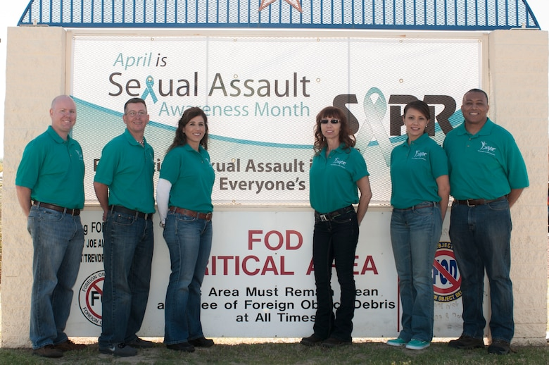 The 162nd Wing Sexual Assault Prevention and Response team dressed in jeans and teal shirts for Denim Day 2014, being honored April 18 here at the wing. The team members are, from left to right: Maj. Stephen Moorhead, Sexual Assault Response Coordinator, Master Sgt. Brent Thompson, victim advocate, Master Sgt. Marnie Jewell-Johnson, victim advocate, Tech. Sgt. Mitzi Eggers, victim advocate, 1st Lt. Melissa Gonzalez, SARC, Master Sgt. Gary Jack, victim advocate. (U.S. Air National Guard photo by Tech. Sgt. Hollie Hansen/Released)