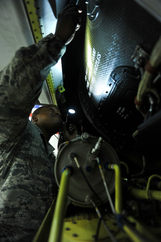 Staff Sgt. Jahmal Maloney, a 380th Expeditionary Aircraft Maintenance Squadron dedicated crew chief, inspects the hydraulic reservoir of an RQ-4 Global Hawk prior to a flight April 15, 2014, at an undisclosed location in Southwest Asia. The reservoir ensures all of the hydraulic components on the aircraft are properly functioning during flight. Maloney, a New Port, R.I., native, is deployed from Beale Air Force Base, Calif. (U.S. Air Force photo by Tech. Sgt. Russ Scalf/Released)