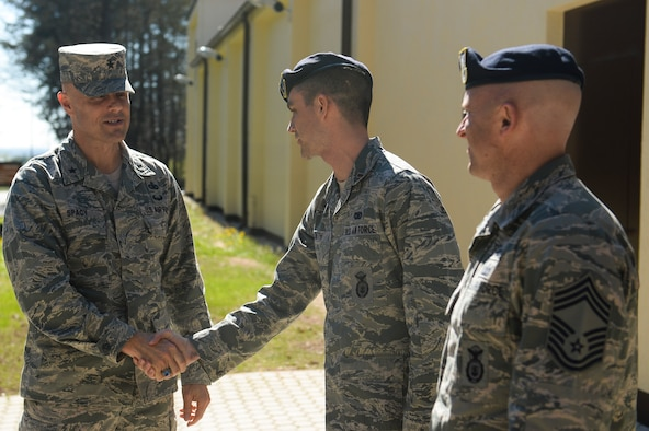 U.S. Air Force Brig. Gen. Bradley Spacy, United States Air Forces in Europe and Air Forces Africa director of logistics, installations and missions support, is greeted by members of the 52nd Security Forces Squadron outside the new Combat Arms Training and Maintenance facility during his visit April 16, 2014, at Spangdahlem Air Base, Germany. During his visit the general met with 52nd Mission Support Group Airmen. (U.S. Air Force photo by Senior Airman Rusty Frank/Released)