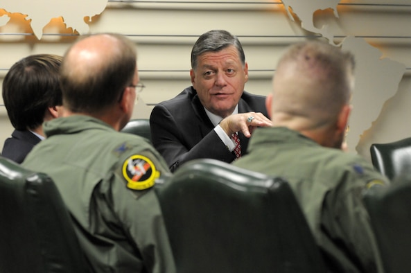 Rep. Tom Cole, R-Okla., talks with Col. David Robertson, the 513th Air Control Group Commander, during a briefing April 18 at Tinker Air Force Base, Okla. During Cole's visit, 513th Airmen explained the Air Force Reserve AWACS mission and the vital role it plays in flying and maintaing the E-3 Sentry Airborne Warning and Control System. (Air Force Photo/Staff Sgt. Caleb J. Wanzer)