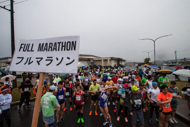 Americans and Japanese participants stretch before beginning the full marathon portion of the 2014 Kintai Marathon, which took place aboard Marine Corps Air Station Iwakuni, Japan, April 13. The marathon is one of the few annual events that give Japanese citizens an opportunity to come aboard station. Approximately 800 people signed up for the full marathon, half marathon and five-kilometer walk.
