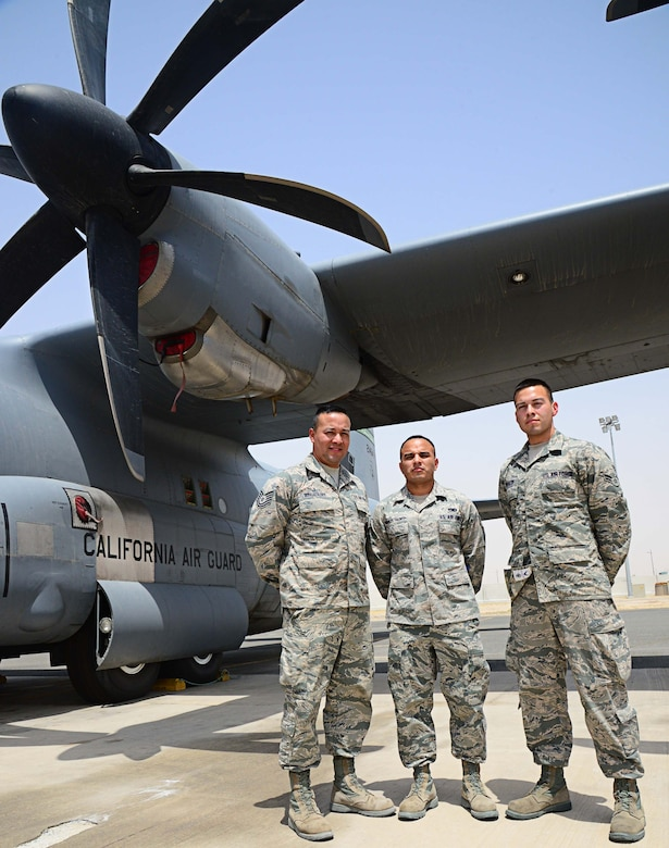 (Left to right) Tech. Sgt. Luis Morales Talento and his little brothers, Senior Airman Walter Morales Talento and Airman 1st Class Guido Morales Talento have been close since growing up in Oxnard, Calif. The Morales Talento brothers are deployed together from the 146th Airlift Wing, Channel Island Air National Guard Station, Calif. Luis is a supply specialist from the 386th Expeditionary Maintenance Group; Walter works at the maintenance operations center controller for the 386th Expeditionary Aircraft Maintenance Squadron;  and Guido is a crew chief with the 386th Expeditionary Aircraft Maintenance Squadron. (U.S. Air Force photo/Senior Airman Desiree W. Moye)