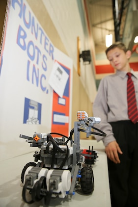 James Richmann, a seventh grade student at Bolden Elementary and Middle School, presents his robot project during the STEMposium, April 10. Seventh and eighth grade students chose between developing a robot or video game, developing their science, technology, engineering and math skills.