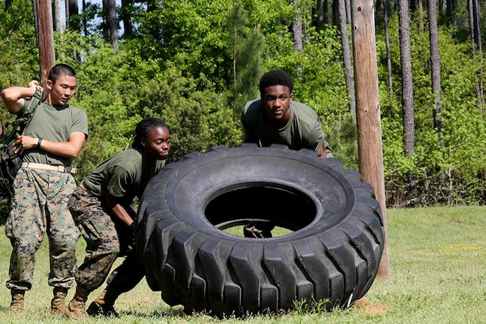 JROTC cadets compete during the 2014 Superintendent's Cup at Bluffton High School, in Bluffton, S.C., April 11. The event hosted five county high school JROTC units to compete in academia, a physical fitness test, an obstacle course, platoon drill, and color guard.
