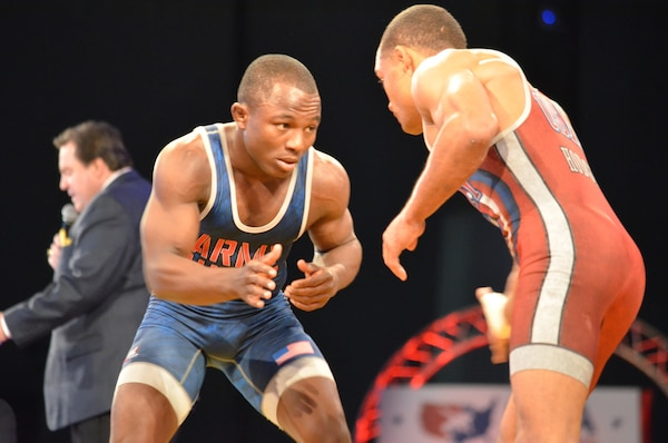 Mango (left) defeats Hodge in the 59 kg/130lbs Greco-Roman semi-finals.