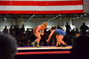 Army SSG Whitney Conder (left) captures her second US National Title competing in the 53 kg/116.5 lbs Women's Freestyle competition.