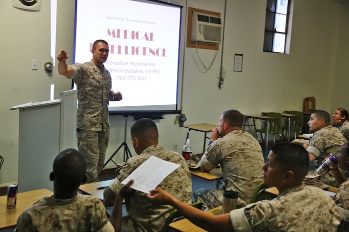 Petty Officer 2nd Class Michael L. Matthews, a corpsman with Preventative Medicine Unit, 1st Medical Battalion, 1st Marine Logistics Group, teaches an Operational Preventative Medicine course aboard Camp Pendleton, Calif., April 16, 2014. The day-long class teaches corpsman measures of preventative care they should consider when planning and conducting operations around the globe. Ten levels of preventative care are taught during the course, including medical intelligence, camp layout, hygiene, habitability, pest management, inspections and reports, waste disposal, water sanitation, disease tracking and food preparation and sanitation. Matthews, 24, is from Arroyo Grande, Calif.