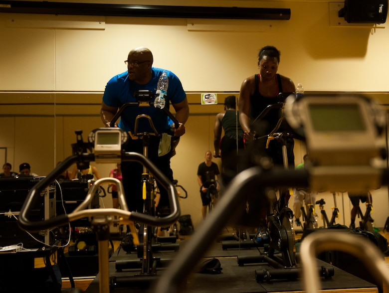Master Sgt. Dante Brooks, 8th Operations Support Squadron host aviation resource management superintendent, and Staff Sgt. Siera Wilson, 8th Operations Group, lead a spin class at Kunsan Air Base, Republic of Korea, April 16, 2014. Spin class is offered four times a week at the Wolf Pack Fitness Center. (U.S. Air Force photo by Staff Sgt. Clayton Lenhardt/Released)