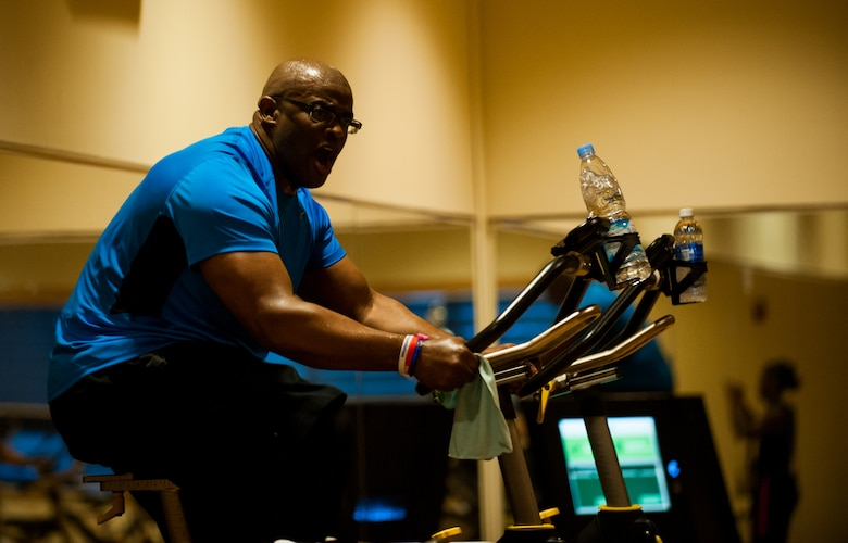 Master Sgt. Dante Brooks, 8th Operations Support Squadron host aviation resource management superintendent, leads a spin class at Kunsan Air Base, Republic of Korea, April 16, 2014. Brooks keeps the Wolf Pack fit to fight by leading spin class four times a week. (U.S. Air Force photo by Staff Sgt. Clayton Lenhardt/Released)