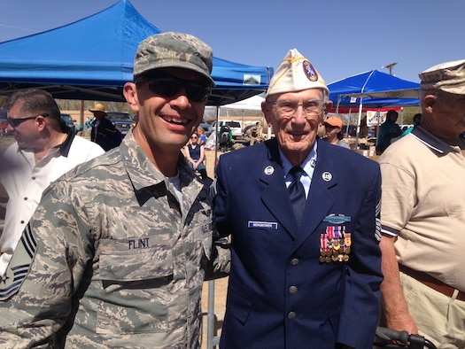 From left, Chief Master Sgt. M. Shane Flint, 543d ISR Group superintendent,  and Chief Master Sgt. (ret.) Harold Bergbower, a survivor of the Bataan prison camps, stand together for a photo, during the Bataan Memorial Death March, March 23, 2014 at White Sands Missile Range, N. M. (Courtesy photo)