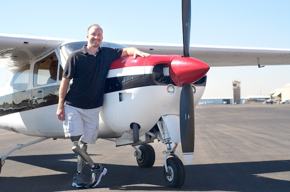 Retired Capt. David Berling, 56th Contracting Squadron contract specialist, stands in front of his 1977 Cessna RG March 23, 2012, at the Glendale Airport. Berling lost his legs in a 2007 plane crash, the subject of which he has written about in a book. (Courtesy photo)