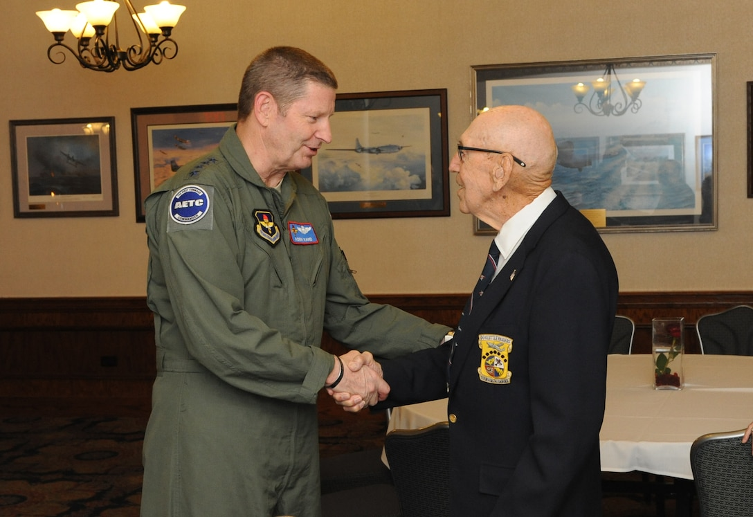 Gen. Robin Rand, Air Education and Training Command commander, shakes hands with retired Lt. Col. Richard Cole, co-pilot of Aircraft No. 1 of the Doolittle Toyko Raid. Cole was honored during the 72nd anniversary celebration of the Doolittle Tokyo Raid of April 18, 1942.  Cole is one of four remaining survivors of the mission. (U.S. Air Force photo by Melissa Peterson)