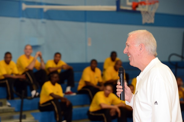 Four-time NBA champion San Antonio Spurs coach Gregg Popovich answers questions Monday from players in the 2012 Armed Forces Men's Basketball Championships while All-Army players listen in the backdrop at Chaparral Fitness Center on Lackland Air Force Base in San Antonio. Tournament play begins tonight with All-Marine Corps vs All-Navy at 5 p.m., followed by All-Army vs. All-Air Force at 7:30 p.m. U.S. Army photo by Tim Hipps, IMCOM Public Affairs